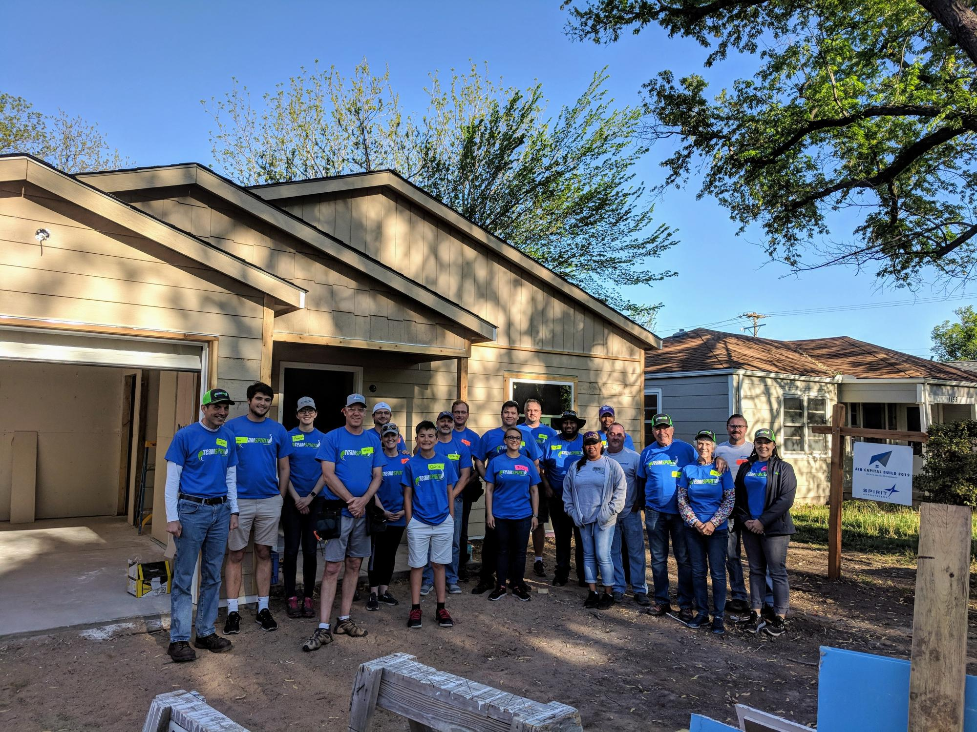 Spirit AeroSystems of Wichita Kansas pose with Tom Gentile and fellow employees at the Habitat for Humanity Air Capital Build in 2019