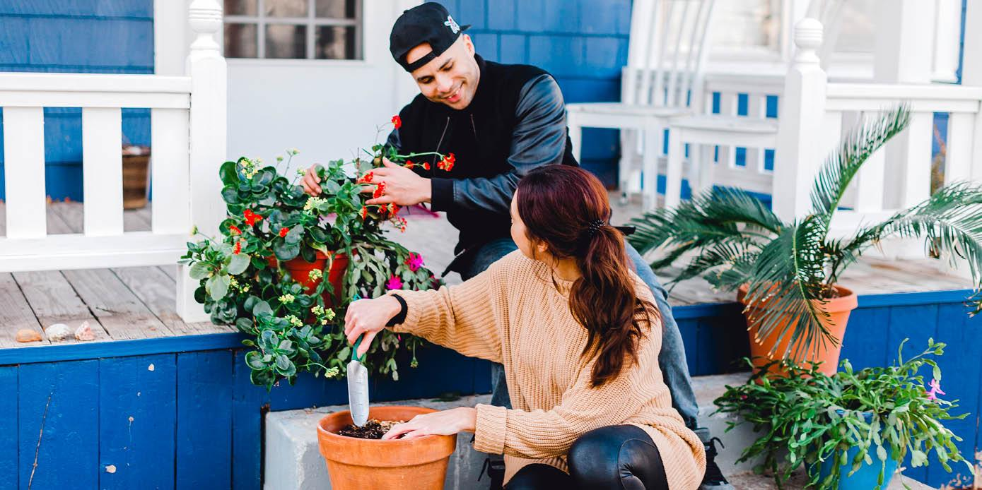 couple planting flowers at home in college hill, wichita kansas